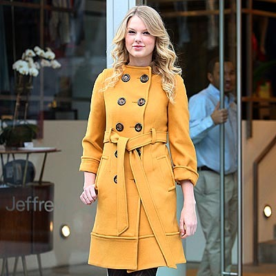 Taylor Swift in a sunny yellow coat