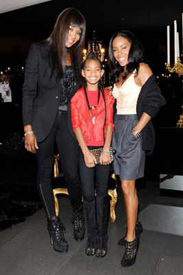 Holding her own with her mom and supermodel Naomi Campbell