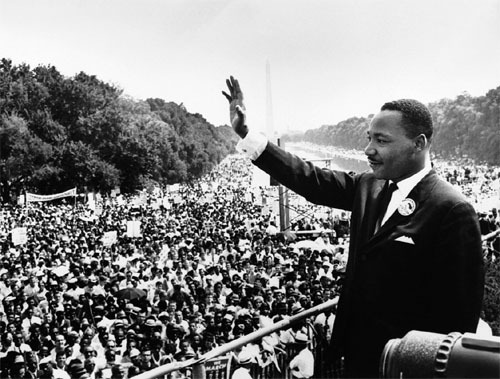 Martin Luther King Jr. waves to participants in the Civil Rights Movement's March