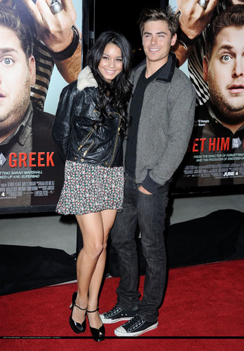With Zac at a movie premiere wearing floral and leather