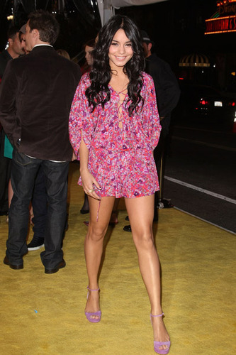 In a floral romper and heels