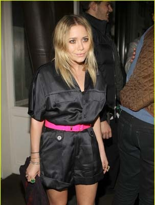 Ashley Olsen belts her romper with pink