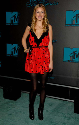 Whitney pairs a red polka dot dress with leather ankle boots!