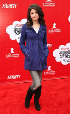Selena Gomez picks a punch purple trench