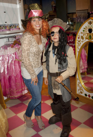 SANTA MONICA PLACE - OCTOBER 2011: Cameron Candace with her children at the Disney Store Halloween BOOtique