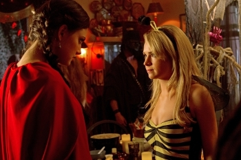 Cassie asks Faye to distract Jake while at the party.