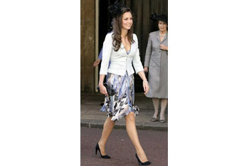 Kate looks ladylike in elegant heels and a headband