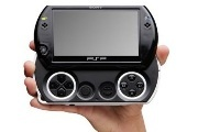 PSP GO held in hand