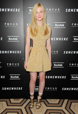 In gold Rodarte dress and shoes