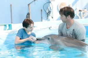 NATHAN GAMBLE as Sawyer Nelson feeds WINTER with HARRY CONNICK JR. as Dr. Clay Haskett