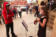 Justin Bieber surprises violinist in his hometown in Never Say Never