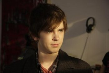 "Freddie Highmore as ""George"""