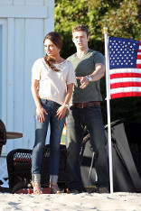 Justin Timberlake and co-star Mila Kunis Hang out near the American flag