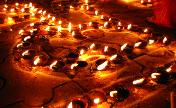 Little clay lamps called diyas are lit during Diwali