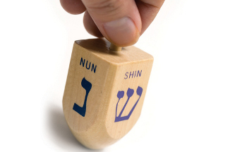 A dreidel is a four sided spinning top