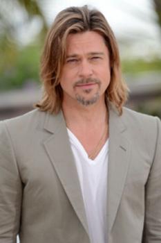 Brad Pitt rocks the t-shirt under blazer look. Add jeans for a casual party or dress slacks for a dress-to-impress evening.