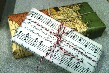 Wrap presents in reused paper, like old sheet music and maps!