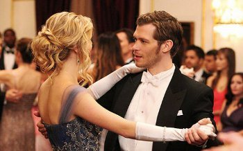 Even though she misses Tyler, Caroline can't resist coming to the ball in the gown that Klaus sent her