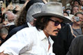 Johnny Depp pulls off the stetson look