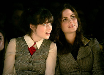 Zooey Deschanel and older sister Emily check out a fashion show together
