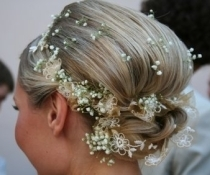 Woven flowers in the hair are very romantic