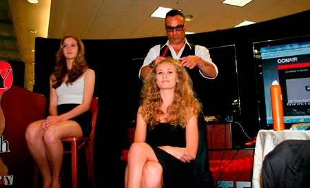 Jonathan styling a model during a promotional event