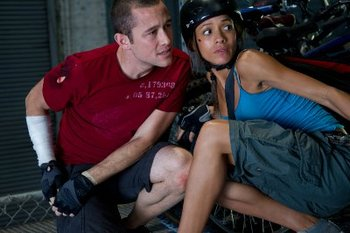 An injured Wilee (Joseph) with girfriend Vanessa (Dania Ramirez)