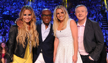 Louis Walsh subs in for Simon Cowell this week.
