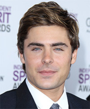 Zac Effron's hair lightly styled with creme, creating a softer look