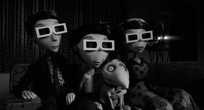 Victor (Charlie), family and dog watch a 3-D film
