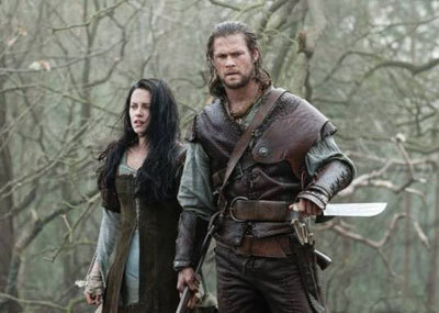 Kristen Stewart and Chris Hemsworth as Snow and her Huntsman