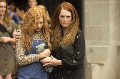 Carrie's mom (Julianne Moore) takes her home from school