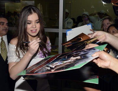 Hailee signs autographs