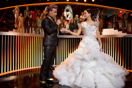 Katniss on stage with host Cesar Flickerman