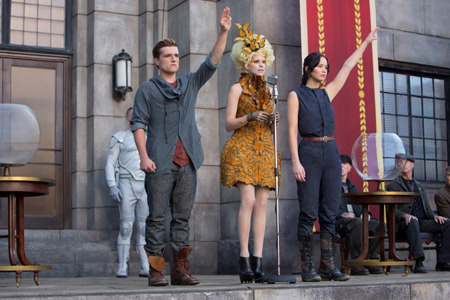 Katniss and Peeta give the rebellion salute