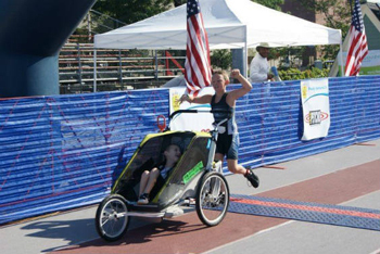 Conner with Cayden Finishing a Triathlon