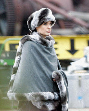 Angelina Jolie in a Russian style faux fur hat and trimmed wrap