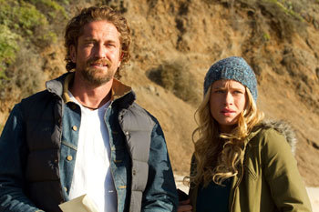 Gerard Butler and Leven Rambin in Chasing Mavericks