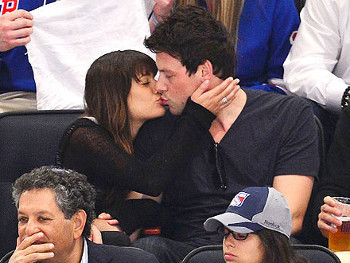 Glee co-stars Lea Michele and Cory Montieth smooch in the stands