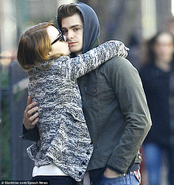 Emma Stone can't keep her hands off Andrew Garfield!