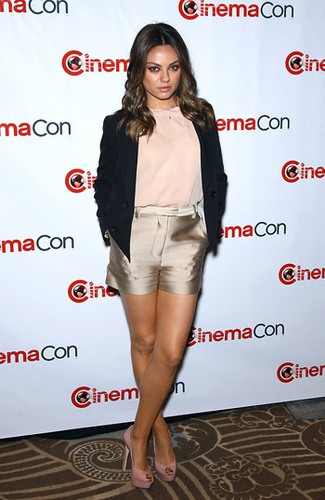 Mila works it in statement gold shorts!