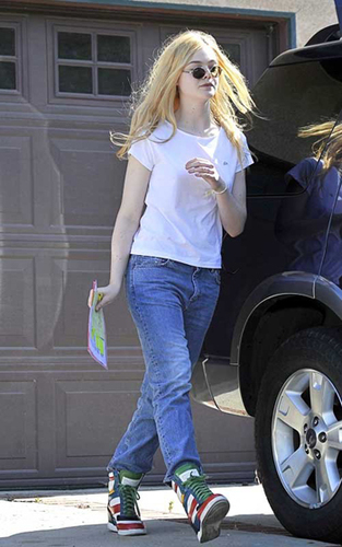 Elle Fanning spruces up a simple outfit with bold sneakers.