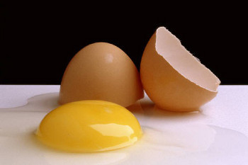 Egg yolks (the yellow bit) have more cholesterol than the whites