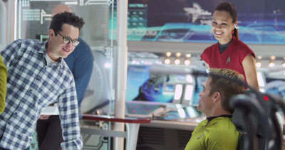 Director J.J. Abrams on set with Chris and Zoe