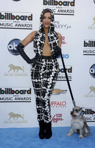 Even Nayer's little dog looks embarrassed by this outfit