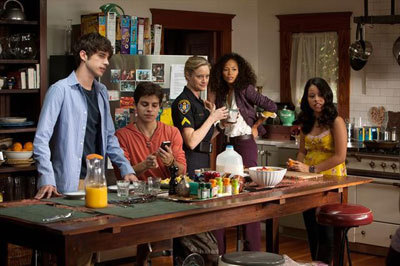 Jake (seated with phone) and cast of The Fosters