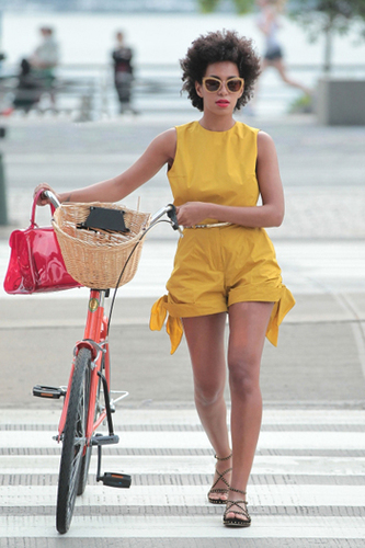 Solange Knowles looks effortlessly cool in a bright playsuit and sandals