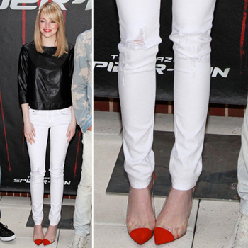 Emma Stone pairs skinny white jeans with black and red.