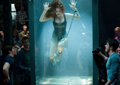 Isla Fisher in water escape trick