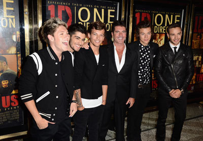 With Simon Cowell at the premiere in London